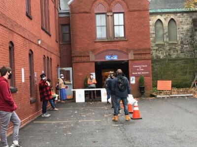 Neighbors in line at St. Luke's back entrance